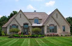 This French Country house plan has an attractive exterior with arch-topped windows, a combination of stone and stucco and lots of windows to take advantage of the views in the back.The great room has a 14 French Country Rug, French Country House Plans, French Country Decorating, Country Houses, French Style, Exterior House Colors, Exterior Design, Exterior Houses, Cottage Exterior