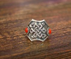 Tibetan Coral Ring with Endless Knot on Etsy, $52.00