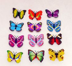 20PCs 10cm Simulated decor colorful butterfly with magnetic-iron could easy stick to your fridge and other items with metal! decorate your room! Also could stick to the wall with adhesive! Make your world with group of butterflys!decor butterflies!Various colors and styles LLONG http://www.amazon.com/dp/B00E77KS18/ref=cm_sw_r_pi_dp_TQ1kub14JTPQ6