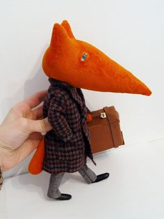 Stylish Fox!  I'm not sure what this, other than a stuffed fox with a multitude of outfits, because all the comments on the original site are in a Cyrillic language, but he sure is cute!