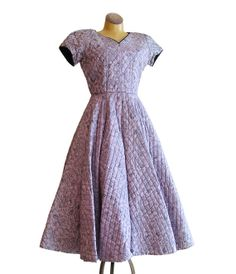 Awesome 1950s quilted pink and black Asian print dress. #vintage #1950s #dresses #fashion
