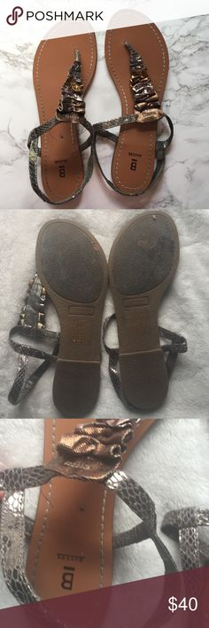 Bakers Metallic Sandals Worn Bakers slip on sandals with cute bronze and silver scrunching. They are in used condition with some fraying on the straps and a spot on the left foot (as seen in the picture) and the bottoms are pictured Bakers Shoes Sandals