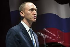 Carter Page speaks at the graduation ceremony for the New Economic School in Moscow in July.  U.S. intelligence officials are seeking to determine whether an American businessman identified by Donald Trump as one of his foreign policy advisers has opened up private communications with senior Russian