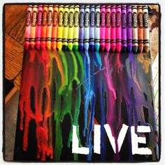 Crayon Art. Tape word on white canvas. Paint black. Let dry. Glue crayons on top. Let dry. Blow dry crayons on low setting, focusing on crayon tips. Hold canvas vertically, tilting slightly.  Let dry. Peel tape off. Blow dry crayons on low again - use angle of canvas and blow dryer to focus melted crayons onto white space. Let dry.