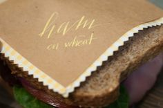 Kraft Sandwich Wrappers with Yellow Calligraphy and Scalloped Edges
