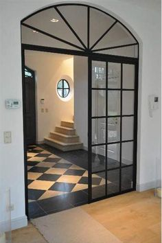 The combination of stone,steel . Hallway Decorating, Steel Frame Doors, Entry Foyer, Windows And Doors, House Styles, House Interior, Floor Colors, Edwardian House, Grey Exterior