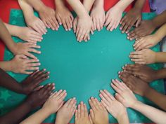 "Hands in a heart shape for class photo...could put ""Mrs. Teacher's Class"" in the middle."