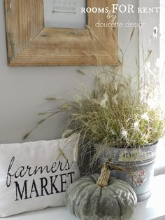 Old maple syrup bucket filled with wheat grass, Cinderella pumpkin, 'Farmers Market' pillow