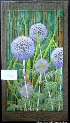 """Globe Thistle, 40 x 22"""", by Aileyn Renli Ecob.  Photo by Quilt Inspiration.  2015 DVQ show."""