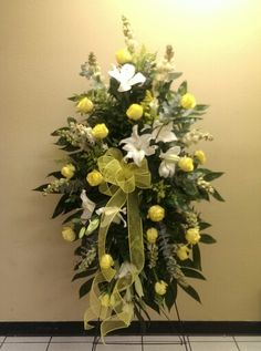 Yellow roses with white lilies standing spray