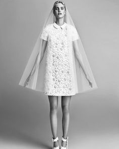 Embellished mini wedding dress with short sleeves and collar.