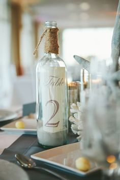 table number bottles for beach wedding | photo: monika gauthier | via decorate for beach wedding ideas from emmalinebride.com Nautical Wedding, Nautical Table, Nautical Centerpiece, Beach Wedding Centerpieces, Seaside Wedding, Wedding Table Decorations, Wedding Table Numbers, Wedding Seating, Wedding Images