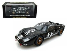 1966 Ford GT-40 MK 2 Black #2 1/18 Diecast Model Car by Shelby Collectibles - Brand new 1:18 scale diecast model of 1966 Ford GT-40 MK 2 Black #2 die cast model car by Shelby Collectibles. Brand new box. Rubber tires. Made of diecast metal. Has steerable wheels. Has opening hood, doors and trunk. Detailed exterior, interior, engine compartment. Dimensions approximately L-10.5, W-4, H-3.5 inches. Please note that manufacturer may change packing box at anytime. Product will stay exactly the…