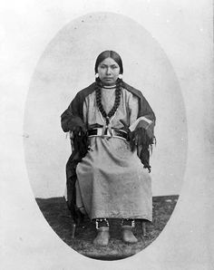 Nez Perce woman, either daughter or younger wife of Chief Joseph, ca. 1875. Photographer J. D. Maxwell, Thomas A. Ley, Studio Location: Dayton, Wa, USA -    Notes: Young woman sits for portrait, with blanket around shoulders, wearing abalone shell earrings, beaded necklace, decorated belt, beaded moccasins.