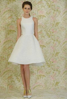 Subtle and sweet cutouts from the Angel Sanchez Spring 2015 collection... perfect for a bridal shower or a most casual bride! | The Knot blog