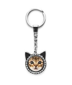 We are all a little crazy for our cats; often referred to as crazy cat ladies - so why not embrace it right? This cat keychain doubles as a photo frame.
