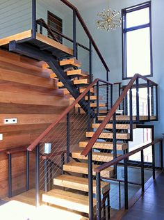 Sweet- This is what I want in my house. Black aluminum, steel wire and Ipe wood to top it off, all inside the home. I give it a 8 out of What kind of score would you give it. Indoor Railing, Loft Railing, Staircase Railings, Wood Stairs, Railing Design, Stairways, Railing Ideas, Staircase Ideas, Cable Railing Systems