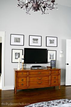 Gallery wall around TV and walls painted in Whitestone (light gray color).