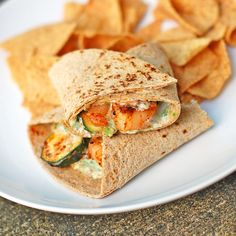 Garlic Shrimp and Zucchini Wrap - Pinch of Yum This garlic shrimp and zucchini wrap has sauteed garlic shrimp stuffed into a whole wheat tortilla with grilled zucchini. A perfect and simple lunch. Seafood Dishes, Seafood Recipes, Cooking Recipes, Grandma's Recipes, Slow Cooking, Lunch Recipes, Summer Recipes, Healthy Recipes, Sauteed Garlic Shrimp