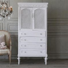Cute vintage armoire with four drawers and one internal shelf in the cupboard. The doors are covered in cane, and a simple carved flower heads adorn the outside frame of this lovely piece painted in a very subtle pink hue. Vintage Armoire, French Armoire, Painted Armoire, Inside Cabinets, Antique Decor, French Country Style, Interior Design Services, Home Collections, Furniture Decor