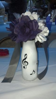 One of the sheet music bouquets used as a centerpiece
