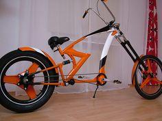 Orange, white n black chopper bicycle