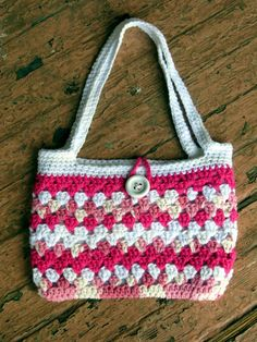 Shades of pink (lined) granny stitch purse. Used this pattern, but made the handles longer. http://www.ravelry.com/patterns/library/granny-stripe-boutique-bag