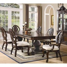 Host your next family gathering with the inviting detailed intricacies of the rectangular dining table and chair set. The table includes one 24-inch leaf that extends this table to 108-inches.