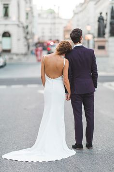 Bride wears a Backless Made With Love Dress. Images by Kirsty MacKenzie #weddingdress #weddinggown #bridalgown #bridaldesigner #weddingfashion #weddingstyle #backlessweddingdress