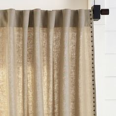 Linen panel with back-tabs and decorative nails down the leading edge