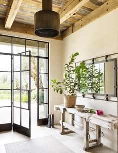 Our favorite use of steel framed doors is when classical meets contemporary (and lets in the light)!