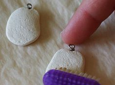 use a toothbrush for nice texture on polymer clay, then paint the stone 'teal' or 'coral' and allow to dry, then 'antique' with gold or silver :)