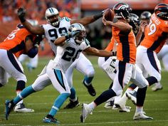 Carolina Panthers safety Kurt Coleman, left, rushes Denver Broncos quarterback…