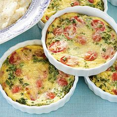Tomato-Herb Mini Frittatas - Breakfast in Bed Recipes to Make Mama's Day - Southernliving. Recipe: Tomato-Herb Mini Frittatas Serve Mom an individual-size frittata packed with the flavors of fresh herbs, juicy grape tomatoes, and savory Italian cheese. Egg Recipes, Brunch Recipes, Breakfast Recipes, Cooking Recipes, Cooking Time, Catering Recipes, Brunch Food, Brunch Menu, Spinach Recipes