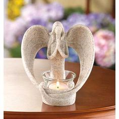 """Desert Angel Candleholder (Item #39695)  A slender seraph shields the light of faith with her bowed wings as she folds her hands in prayer. Stone-look decoration graces your home with a heartwarming dose of hope and faith! Polyresin with glass cup. Candle not included. 5 3/8"""" x 3 7/8"""" x 5 3/4"""" high."""