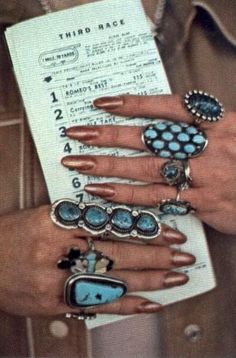 "Turquoise overload! From National Geographic, March 1978: ""At Hot Springs' Oaklawn Jockey Club... One visitor from New Mexico believes in wearing luck on every finger."" Her nails!"