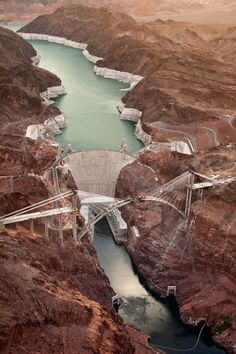 Hoover Dam Bridge: Hoover Dam, once known as Boulder Dam, is a concrete arch-gravity dam in the Black Canyon of the Colorado River, on the border between the US states of Arizona and Nevada.