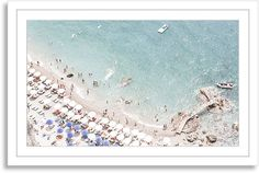 New Era Publishing Judith Gigliotti, Faded Afternoon - From photographer Judith Gigliotti, this image captures a stunning aerial view of the Amalfi coast. This work is printed on high-quality paper, matted, and set in a white wood frame. Fine art photographer Judith Gigliotti creates evocative portraits of nature. Her subjects include vivid fresh flowers, beach scenes around the world, dramatic cityscapes, and the sea. Through her lens these subjects tend to take on an epic quality, like…
