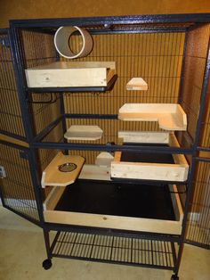 """Chinchilla cage- love the """"poop guards"""" throughout the cage and food bowl sitting inside the ledge to prevent spills. Cage Chat, Chinchilla Care, Marmoset Monkey, Rat Care, Ferret Cage, Rat Toys, Degu, Rabbit Hutches, Ideias Diy"""