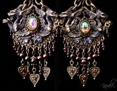 Items similar to Antiqued Gothic Twin Dragon Medieval Chandelier Earrings, Genuine Garnet Gemstone, Large Gargoyles, Medieval Jewelry, Unique on Etsy Beaded Tassel Earrings, Chandelier Earrings, Women's Earrings, Jewelry Gifts, Fine Jewelry, Unique Jewelry, Larp, Gothic, Cosplay