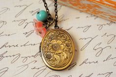 Brass Locket Jewelry Antiqued Floral Locket Jewelry Turquoise Pink Charm Beads Vintage Inspired Charm by LimonBijoux on Etsy https://www.etsy.com/listing/80039832/brass-locket-jewelry-antiqued-floral