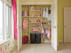 traditional walk in closet for kid which consists of upper and lower hanging sections wire made shelving system open shelves and black bags storage of Dozens of Walk In Closet Organizers Lowes