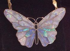 Tucson Show: Snapshots from the 2001 Show: The Main Event III - Going for the Gold- opal inlay