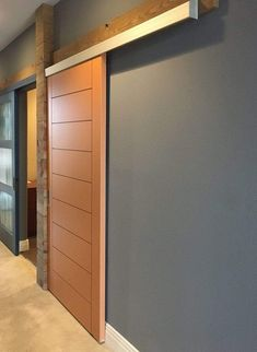 RealCraft wall mount sliding door track kits are designed to work with applications that have tight clearances above the door opening. Its compact design allows the track to fit into tight spaces where standard sliding hardware normally wouldn't fit. This sleek and modern Wall Mounted kit comes with a pre-finished clip-on aluminum fascia and end caps that neatly disguises the top of the door, track, and trolleys to keep a concealed appearances. What makes our wall mount sliding door hardware… Wall, Door Hardware, Solid Doors, Door Hanging, Swinging Doors, Sliding Doors, Wall Mount, Sliding Door Hardware, Doors