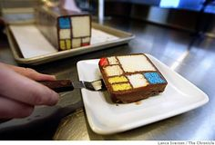 Caitlin Freeman, the pastry chef for the new SFMOMA rooftop garden cafe, plates up a slice of Mondrian cake, inspired by a painting by Piet Mondrian dated 1935-1942 titled Composition with Red, Yellow and Blue