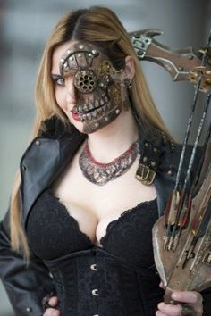A wooden half skull is steampunk makeup perfection. Love the gears, rivets, and teeth! - 11 Steampunk Makeup Designs