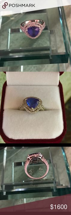Trillion Cut Deep Blue Tanzanite Set 14k Diamonds I am just beginning to sell my vast collect of rings collected over the last 30 years... some just pretty some kind of expensive. Deep blue tanzanite ring with sparkling diamond setting in white gold 14k. I purchased this ring in Martinique and I still have the original receipt for $1800+ Trilliant cut stone Jewelry Rings