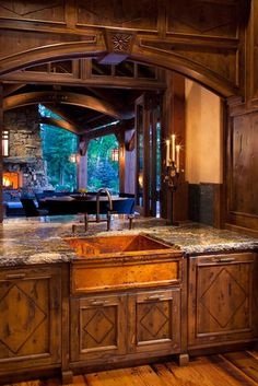 rustic kitchen. Could use cabinets and sink idea for a wet bar in the living room.