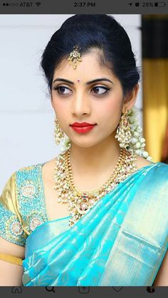 South Indian bride. Gold Indian bridal jewelry.Temple jewelry. Jhumkis. Teal blue silk kanchipuram sari.Braid with fresh jasmine flowers. Tamil bride. Telugu bride. Kannada bride. Hindu bride. Malayalee bride.Kerala bride.South Indian wedding.