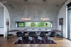 25 Simply Amazing Concrete Interiors | Private residential dining room by EON Architecture in Reykjavik, Iceland #projects #interiordesign #interiordesignmagazine #design #interiors #concrete #dining